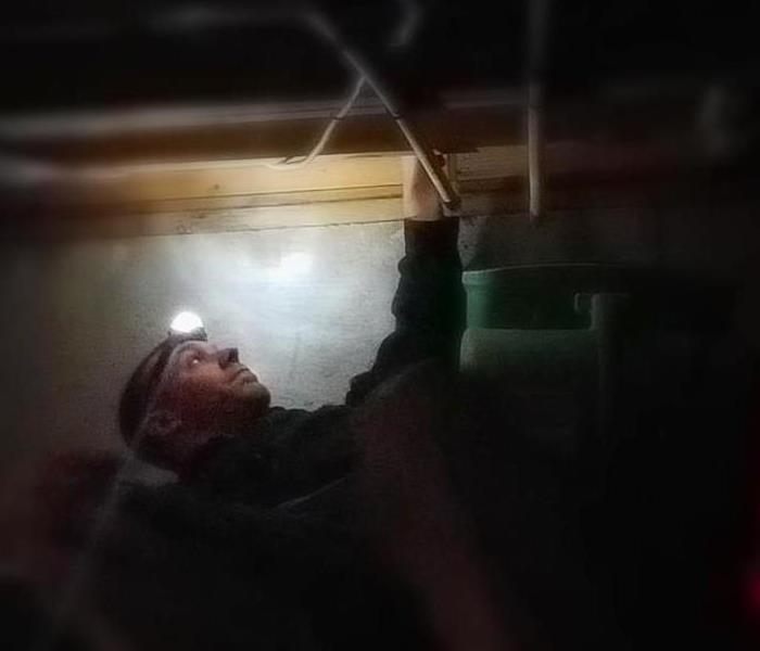 A person using a headlamp to see in the dark.