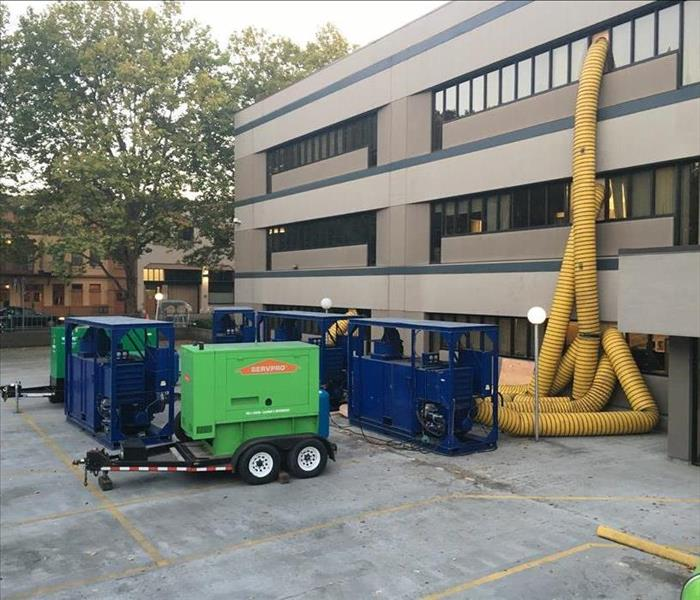 SERVPRO equipment extracts water from a third story commercial space.