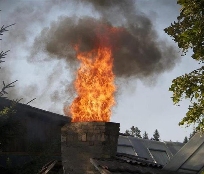 A fire escaping through a home's chimney.